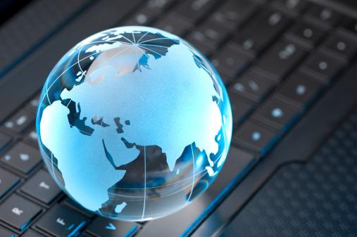 Glass Globe and Computer Keyboard